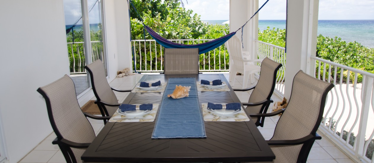 Table, chairs, hammocks off master suite with views!